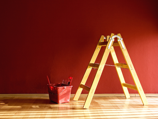 Lounge red room with ladder and red bucket